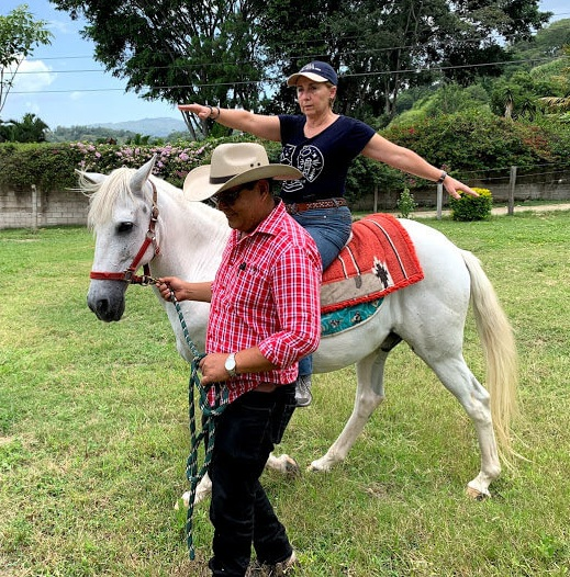 We spent one day with Humberto Solares. Some of you may remember that a team from Open Range Fellowship in Lone Jack, Missouri helped him purchase this horse (named Bambino) for the beginning of an equine therapy program for special needs children. Here, Humberto leads Bambino as Clarissa, an expert in ET from San Jose Pinula, Guatemala, tests the horse's abilities and points some things out to the group gathered for the orientation.