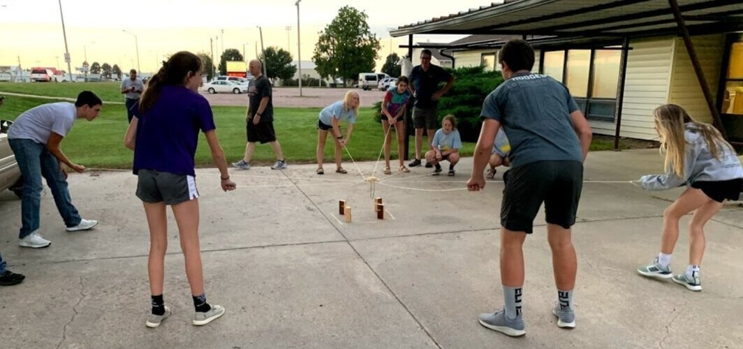 The Burwell Baptist Junior High group invited us to talk to them about our PSE method. Here, they try their hand at a new teamwork game that one of their youth leaders invented.