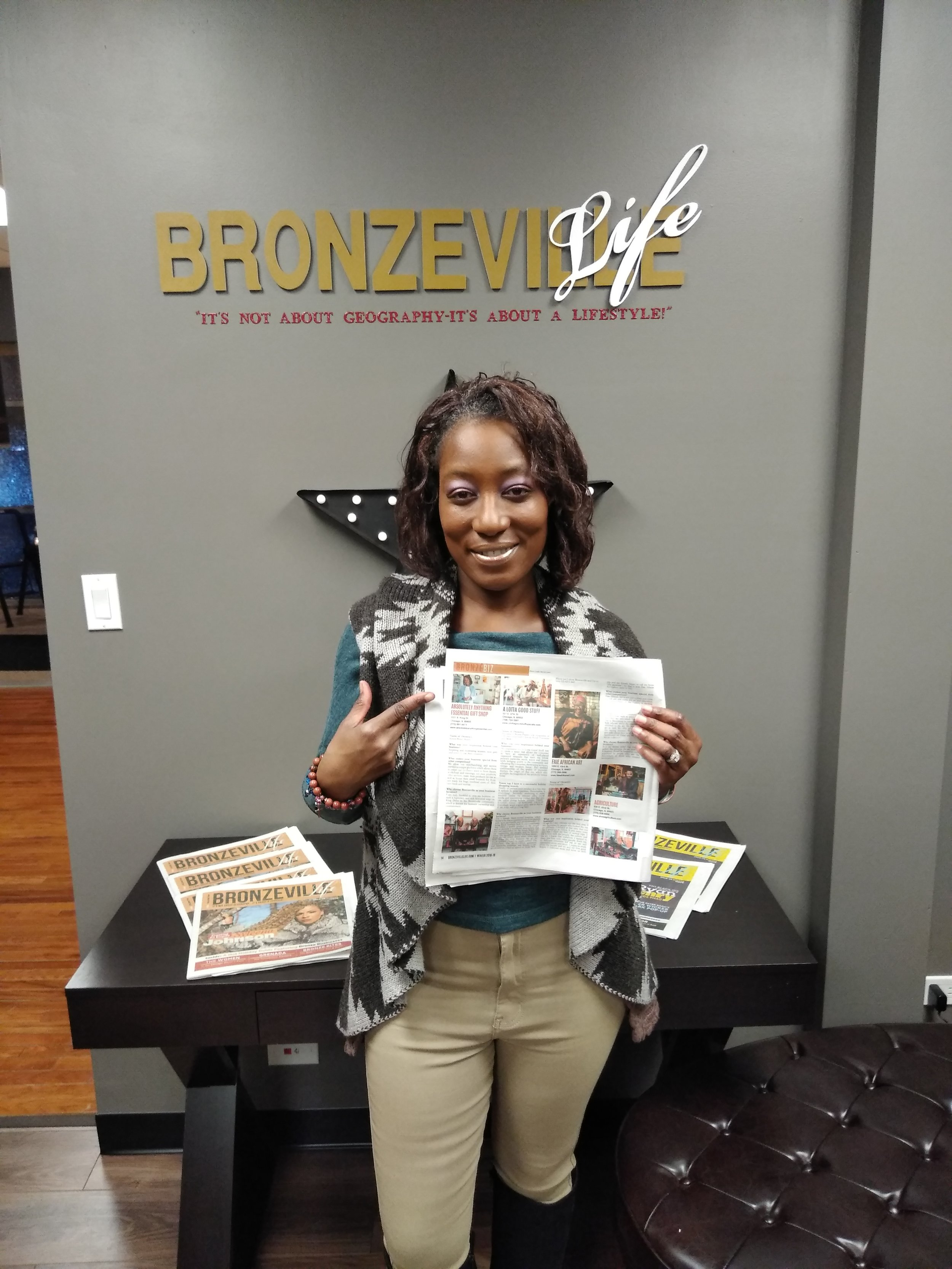 Owner Kenya Renee shows off her business being highlighted in Chicago's new Bronzeville Life Newspaper. Public Relations Professional, Jada Russell, in collaboration with Quad Communities Development Corporation of Chicago made this dream come true. ~Thank you Defender Charities.