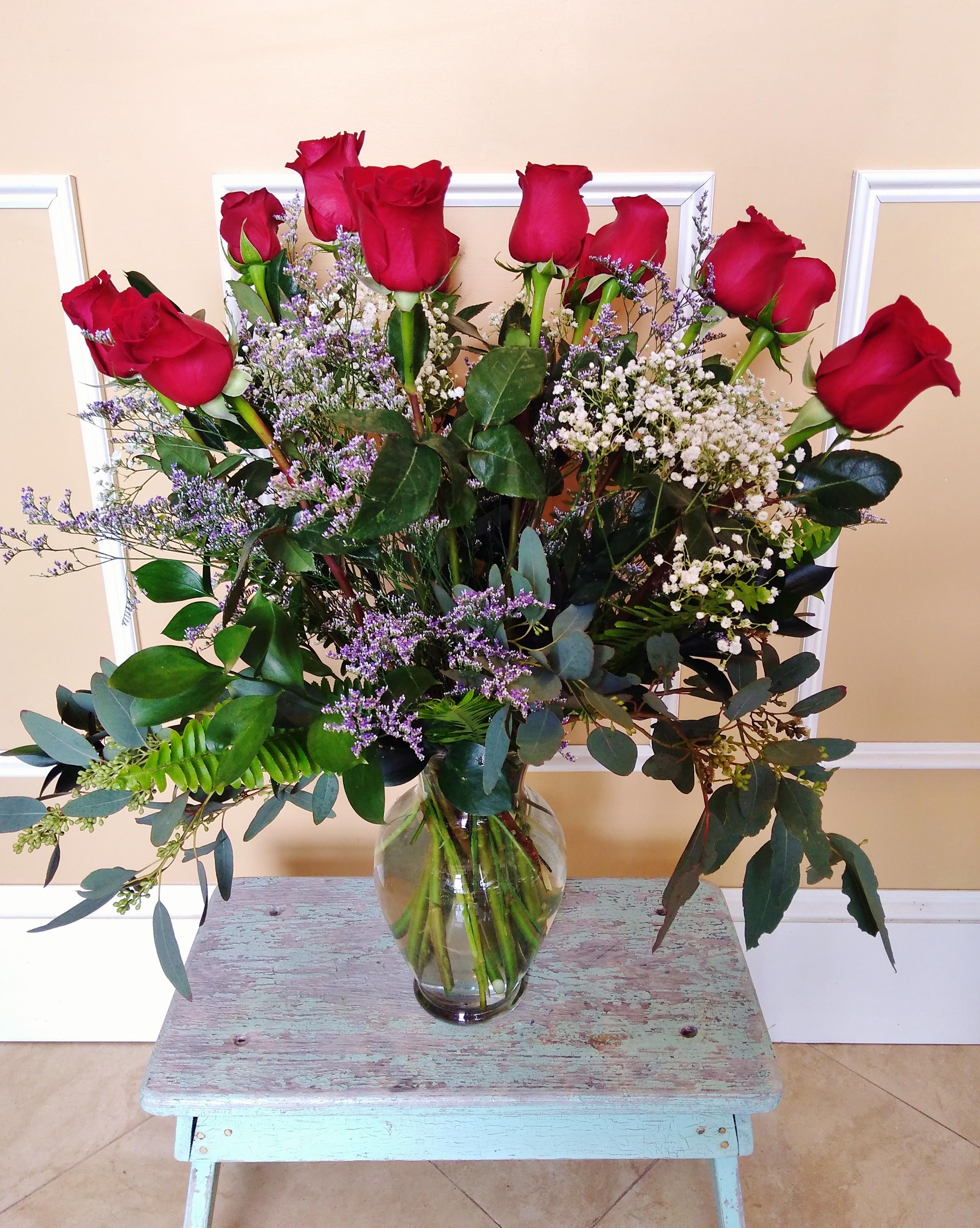 B4 $75  1 Dozen long-stemmed roses.