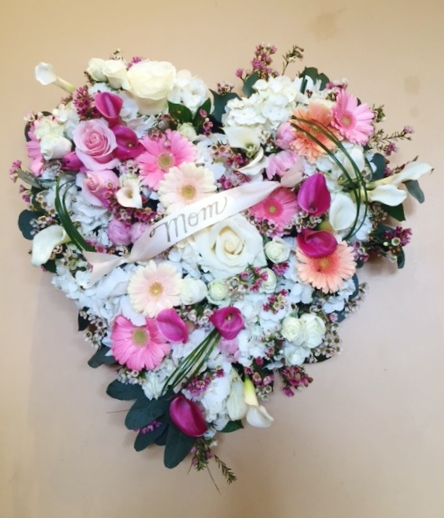"""F15 $150-$200 22"""" Solid floral heart. $200 as shown."""