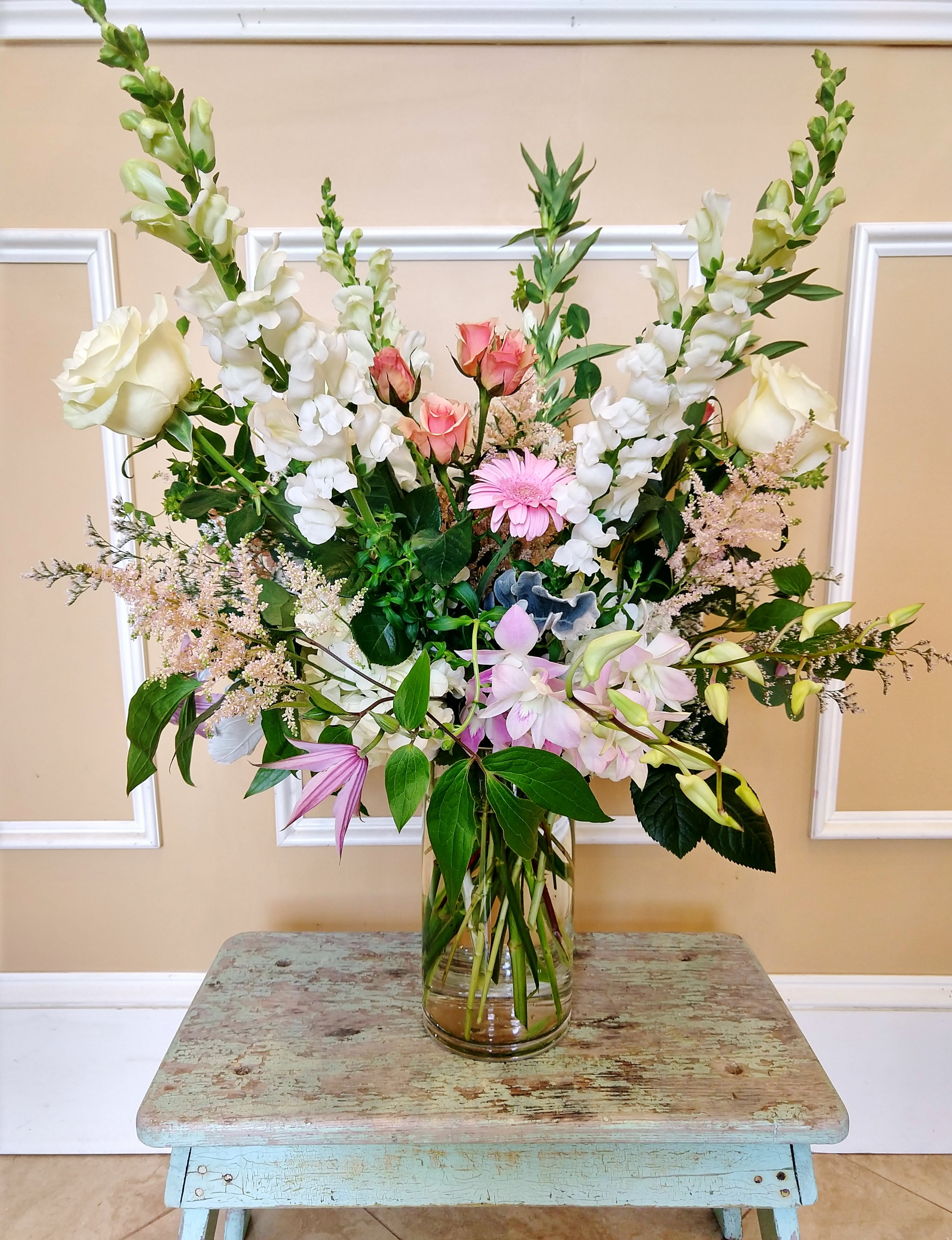 A11 $125-$200 Tall classical style vase arrangement. $125 as shown.