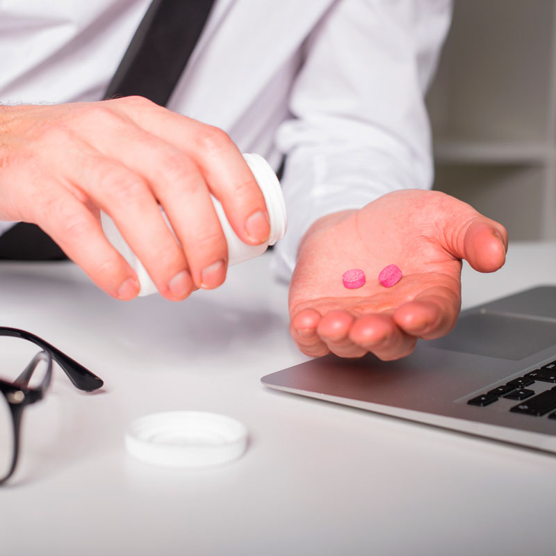 stock-photo-90292275-man-taking-pills-at-the-office.jpg