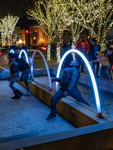 Christmas Limbo  ,  Curtis Hertwig, 2018   In its second year, the Main Street Christmas Light Show Extravaganza brought children of all ages to downtown Macon.