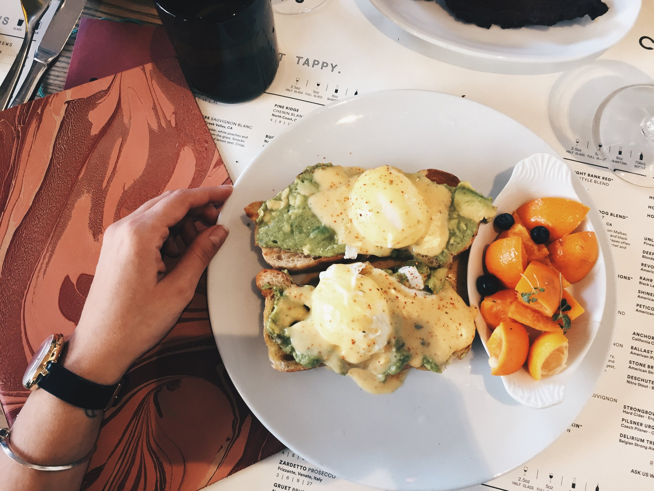 Avocado Eggs Benedict - toasted sea salt ciabatta, avocado smash, free range eggs, togarashi hollandaise and fruit.