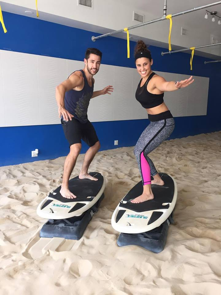 Instructor Quinn and I using our core to balance!