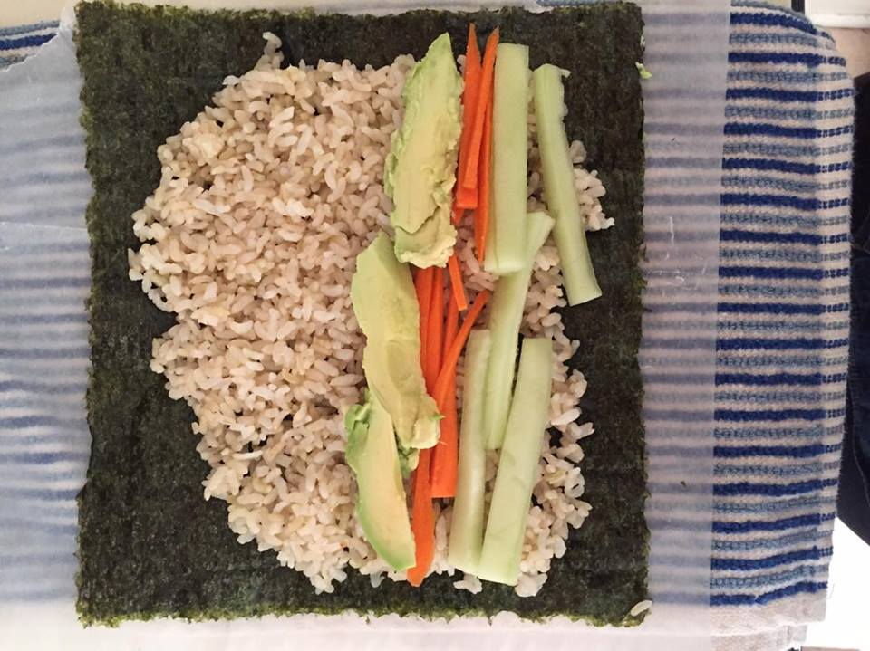 STEP 2: Take cut veggies of choice and place them on top of the rice.