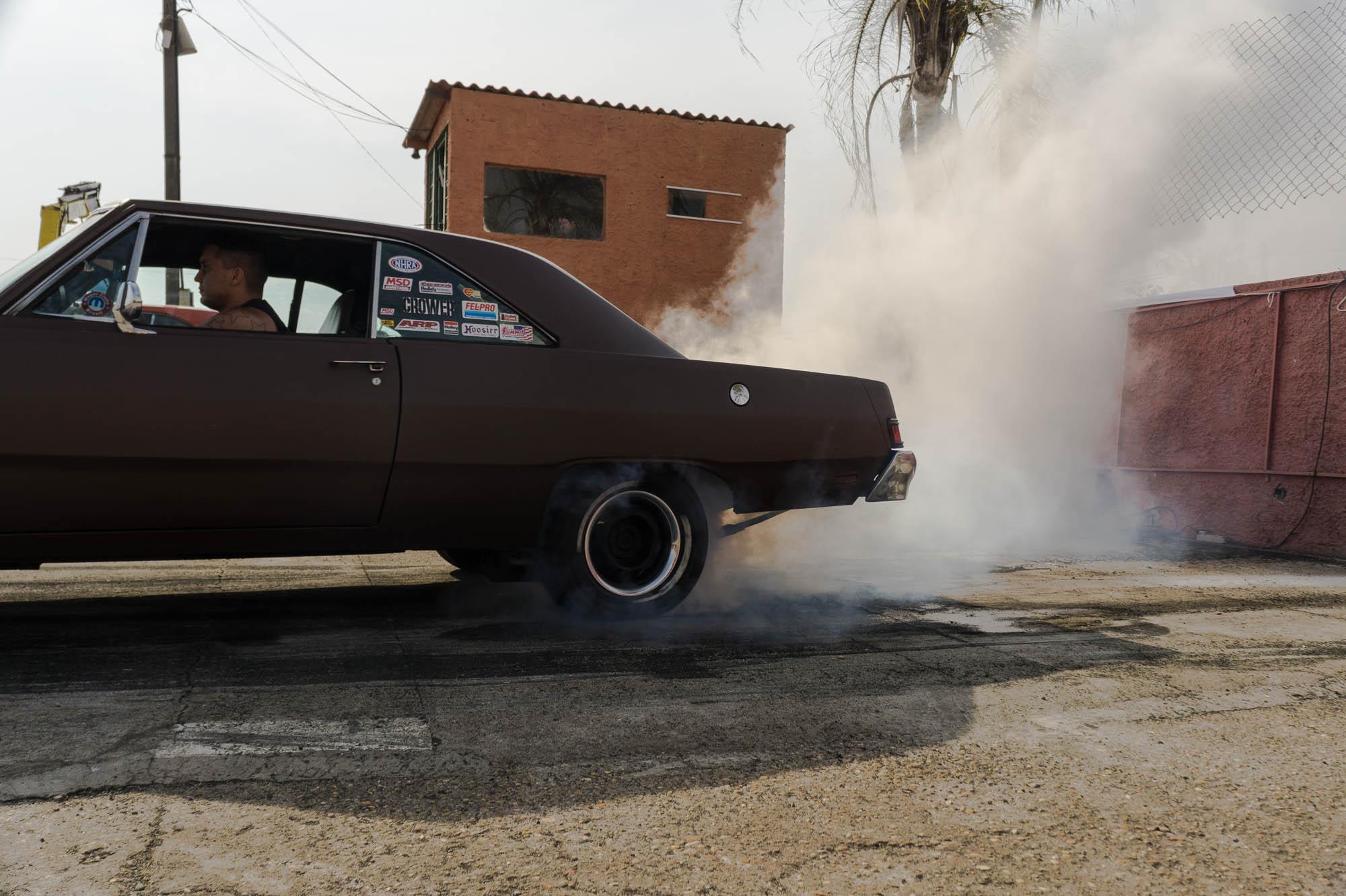 Brown Car Performing a Burnout