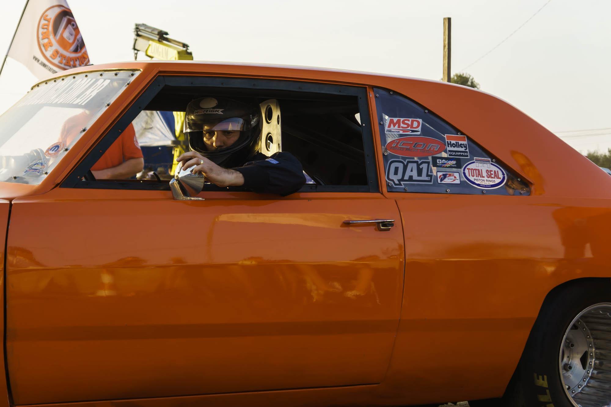 Man in Helmet adjusts Rear Mirror