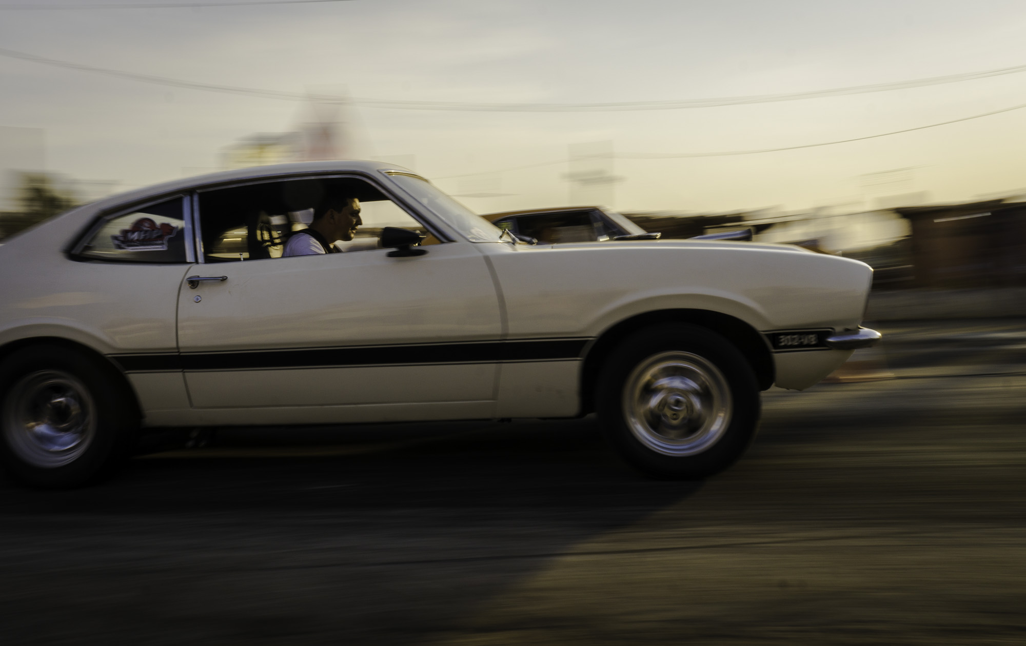 A Ford Mustang launching for a drag race