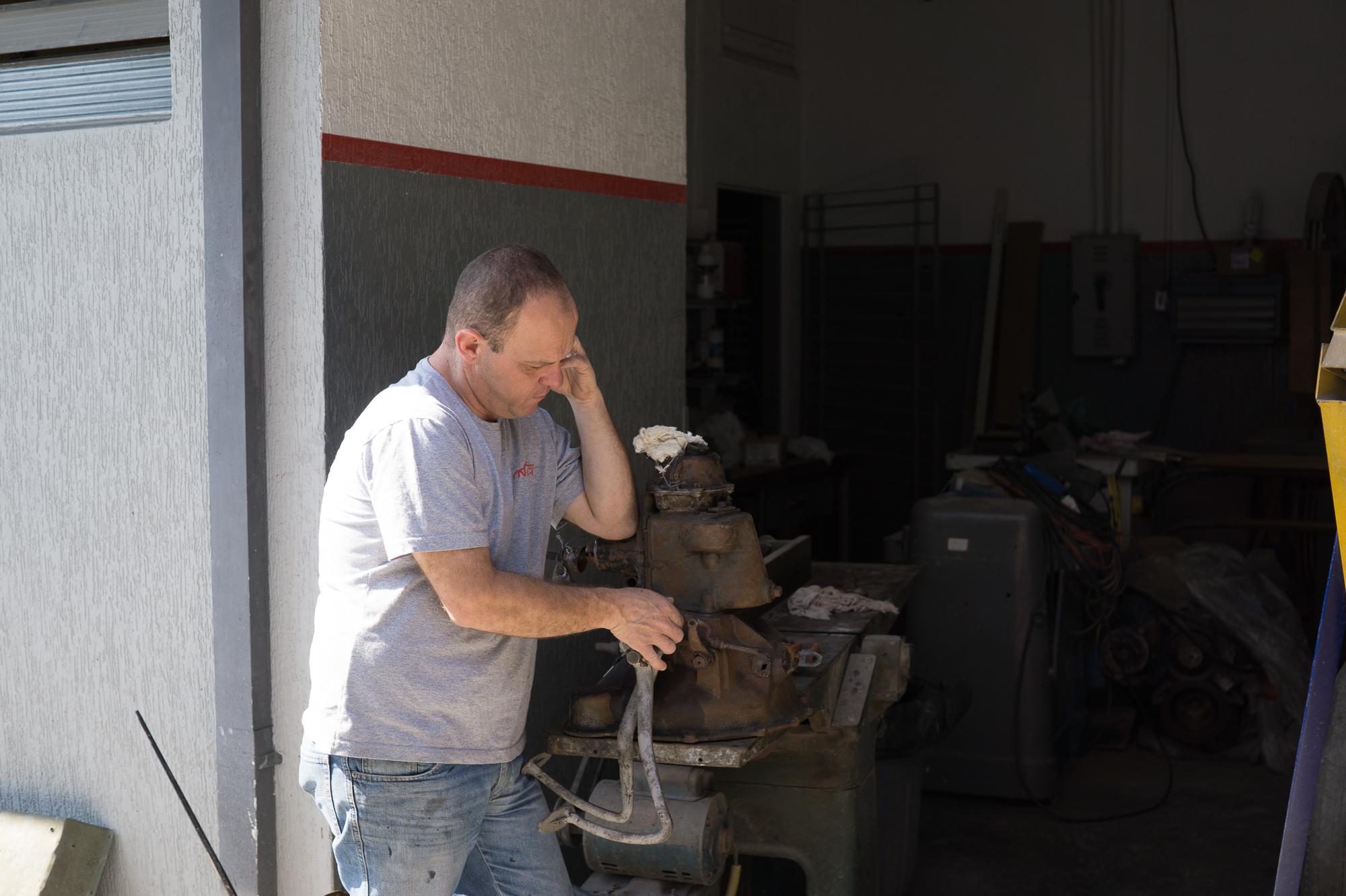 Nika on the phone next to a tool