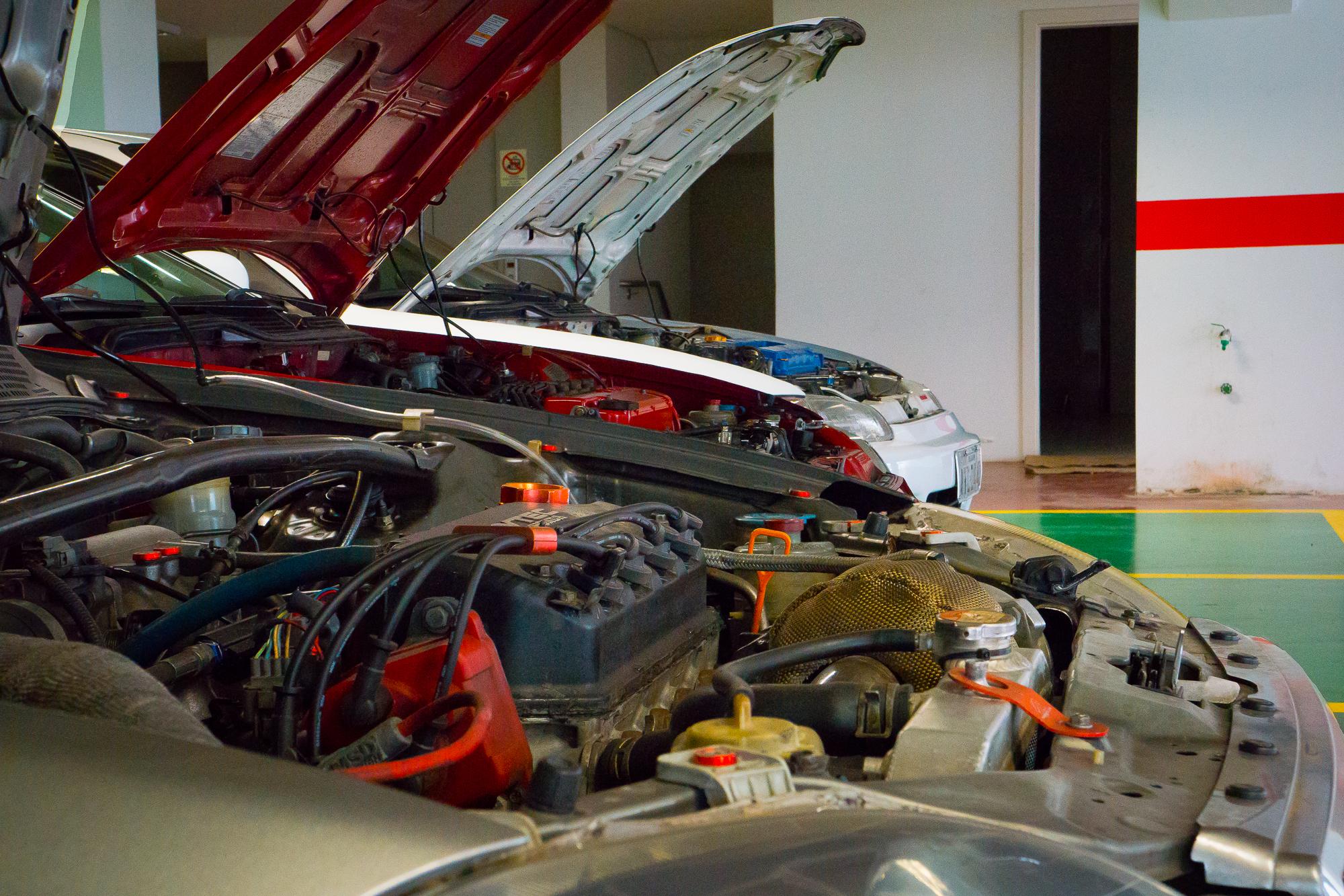 3 Honda Civics with hoods open