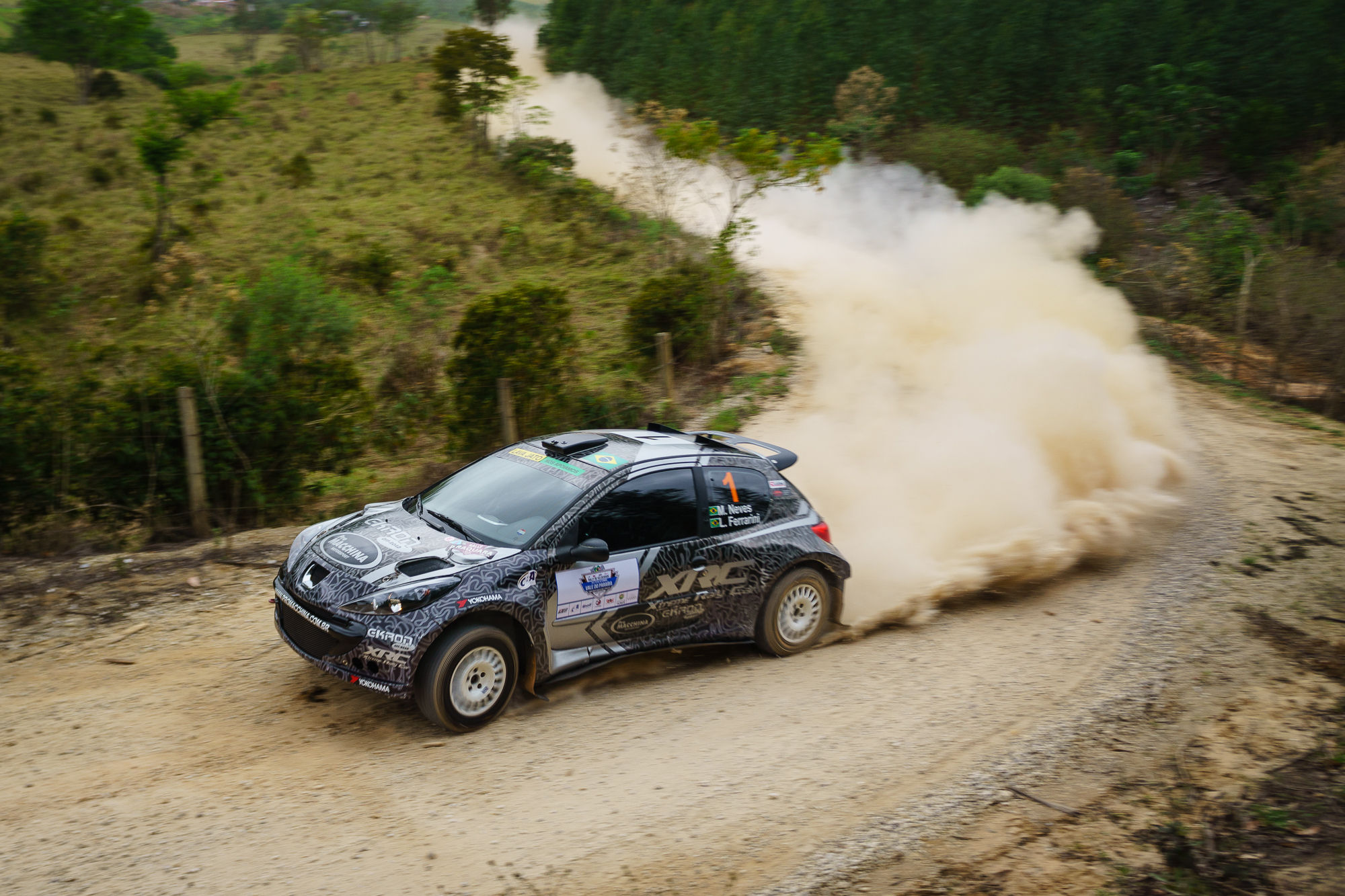 Mauricio NEves' Rally Car taking a corner at a rally