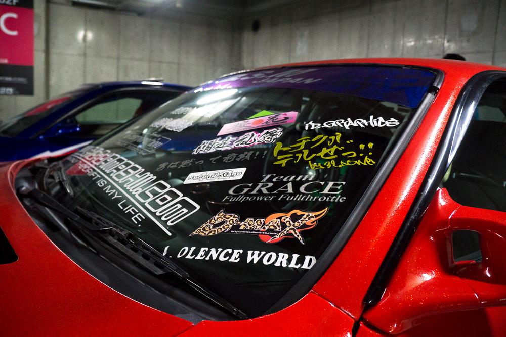 Stickered Windshield Akhibara DX Parking Garage
