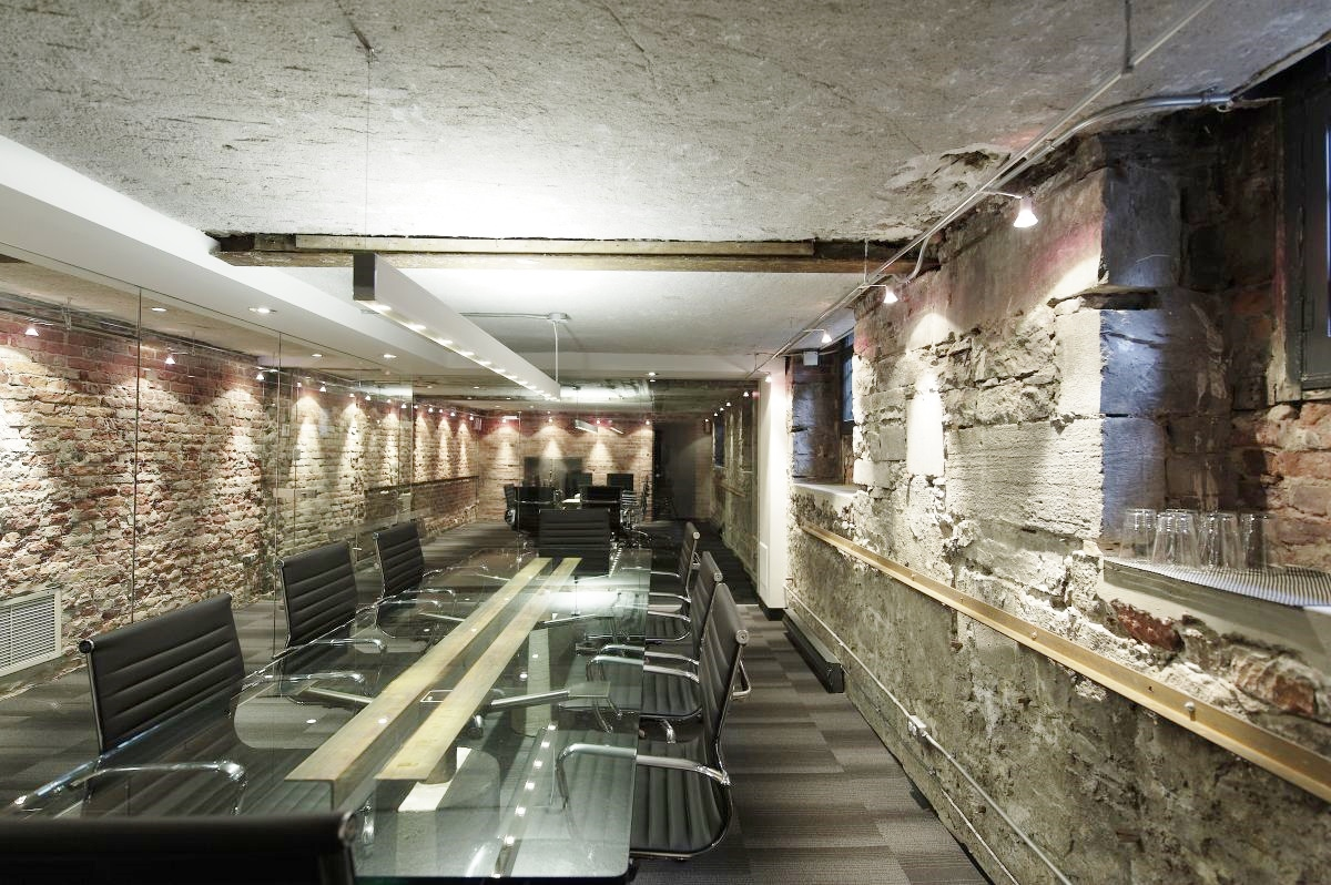 An unused basement in a commercial building becomes an awesome conference room
