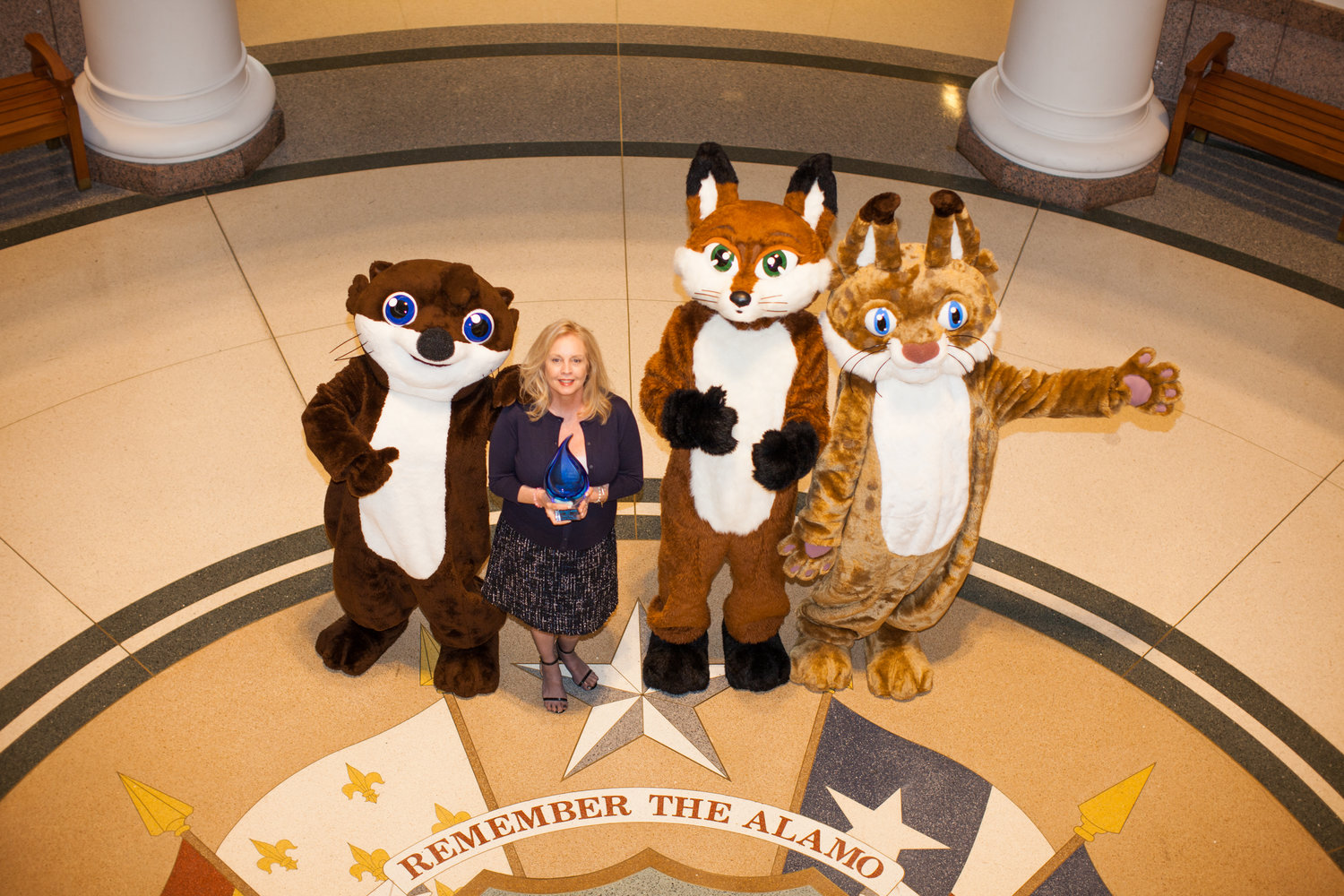 Water4Otter characters at the Texas Capitol after winning the 2017 Watermark Award