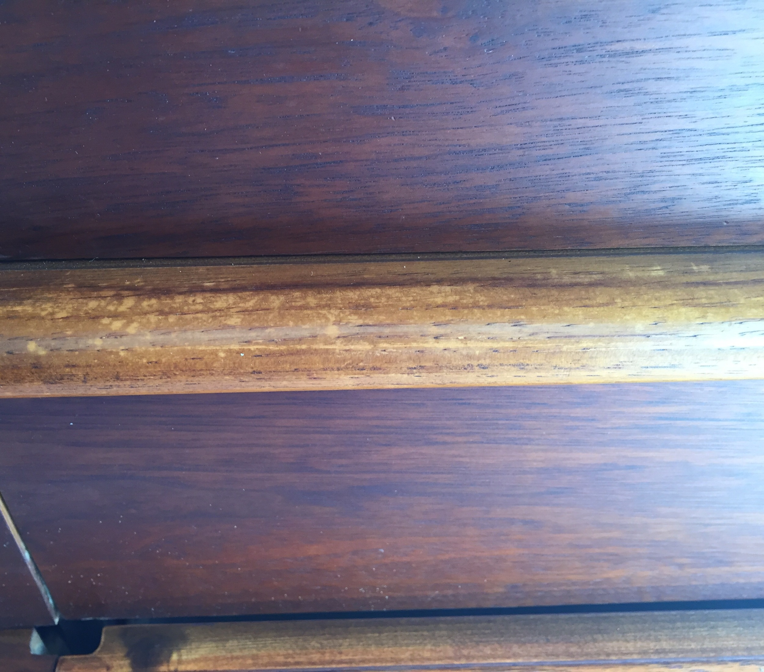 And this is what the drawer handles looked like......definitely need to refinish them now.......more sanding, more staining, more poly.....11 drawer handles!
