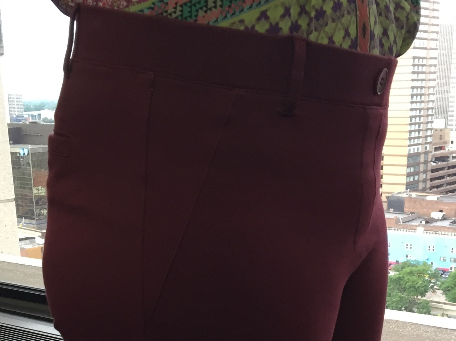 fake pockets (front and back), fake button (okay, real button, but not really closing anything), belt loops - sneaky!
