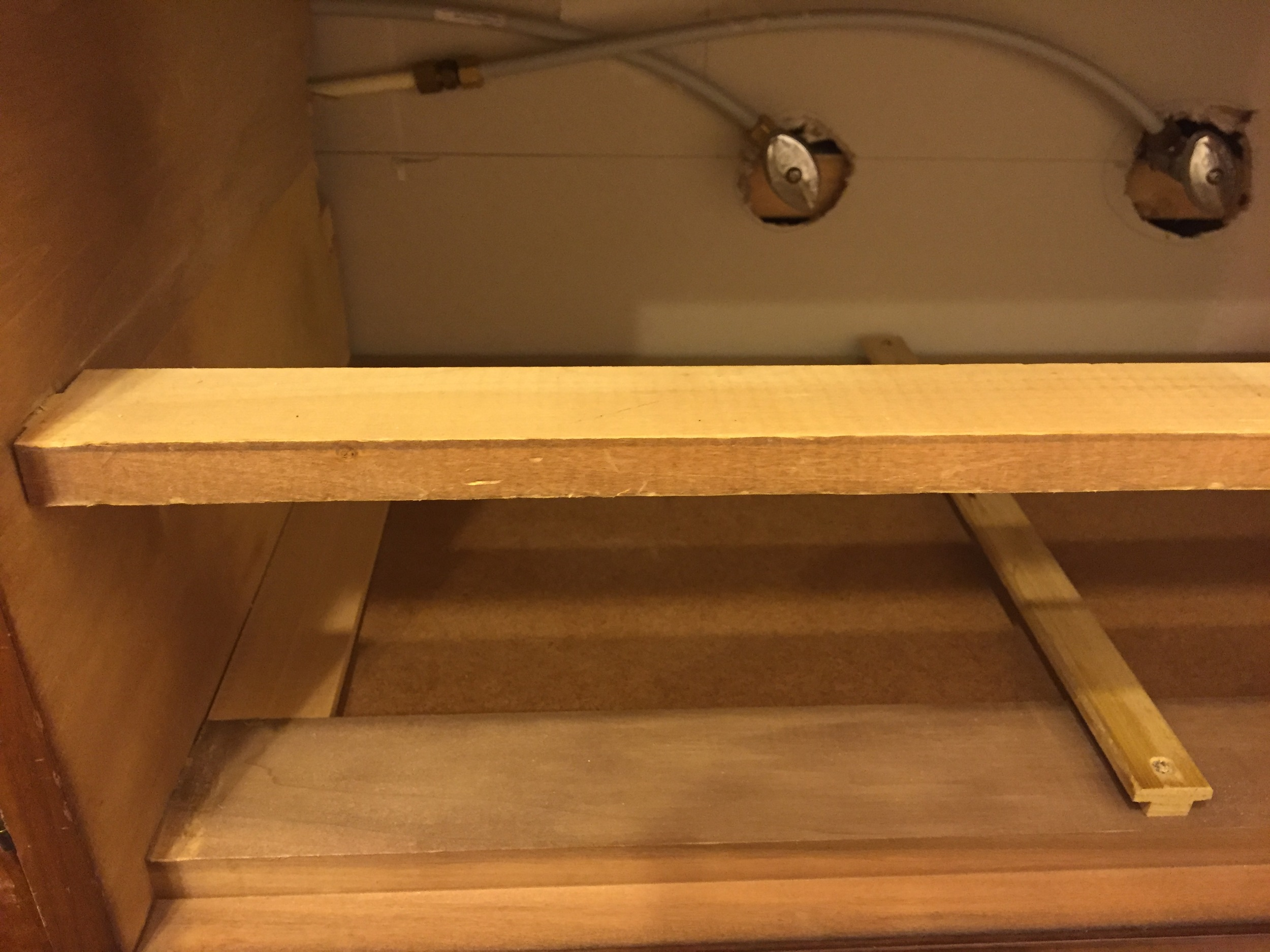 In order to make remove for the those water shut off valves, we had to completely remove the side and back drawer support rails for the middle drawer. See how there's only a front rail remaining?
