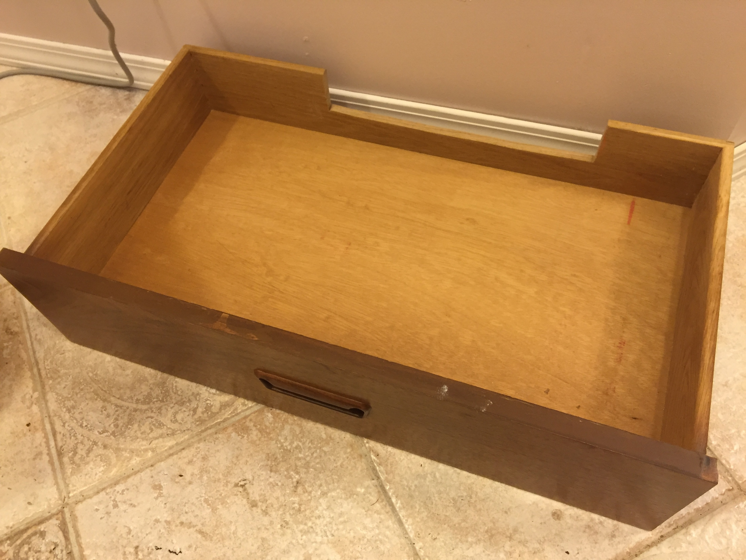 We had to cut a notch into the back of the bottom drawer to make room for the shut off valves.