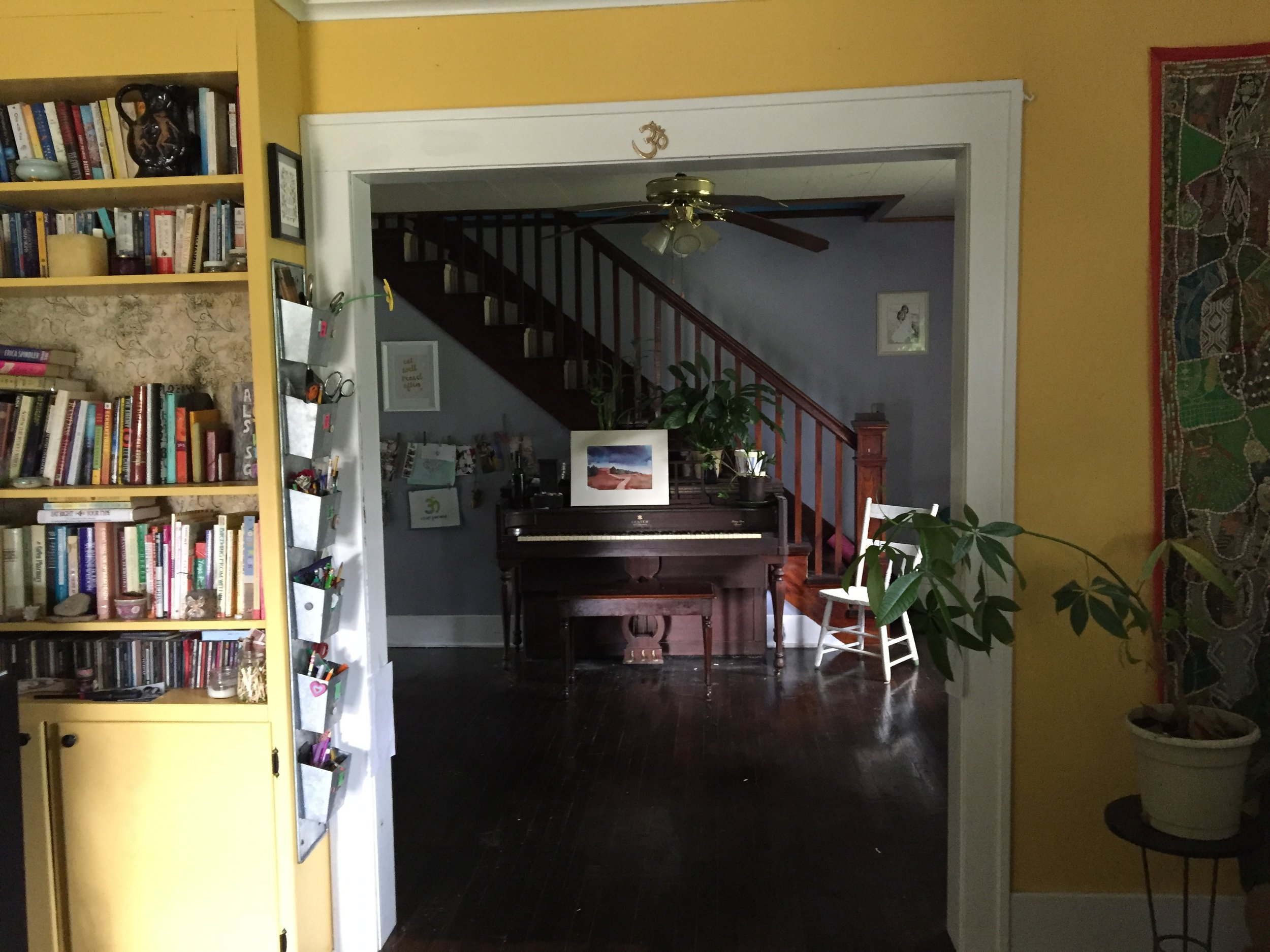 This is the view you see when you first walk into Brooke's home.  You're in the living room, which opens up to the dining room, with a totally inviting view of her piano. To the left is a sunny built in bookshelf.