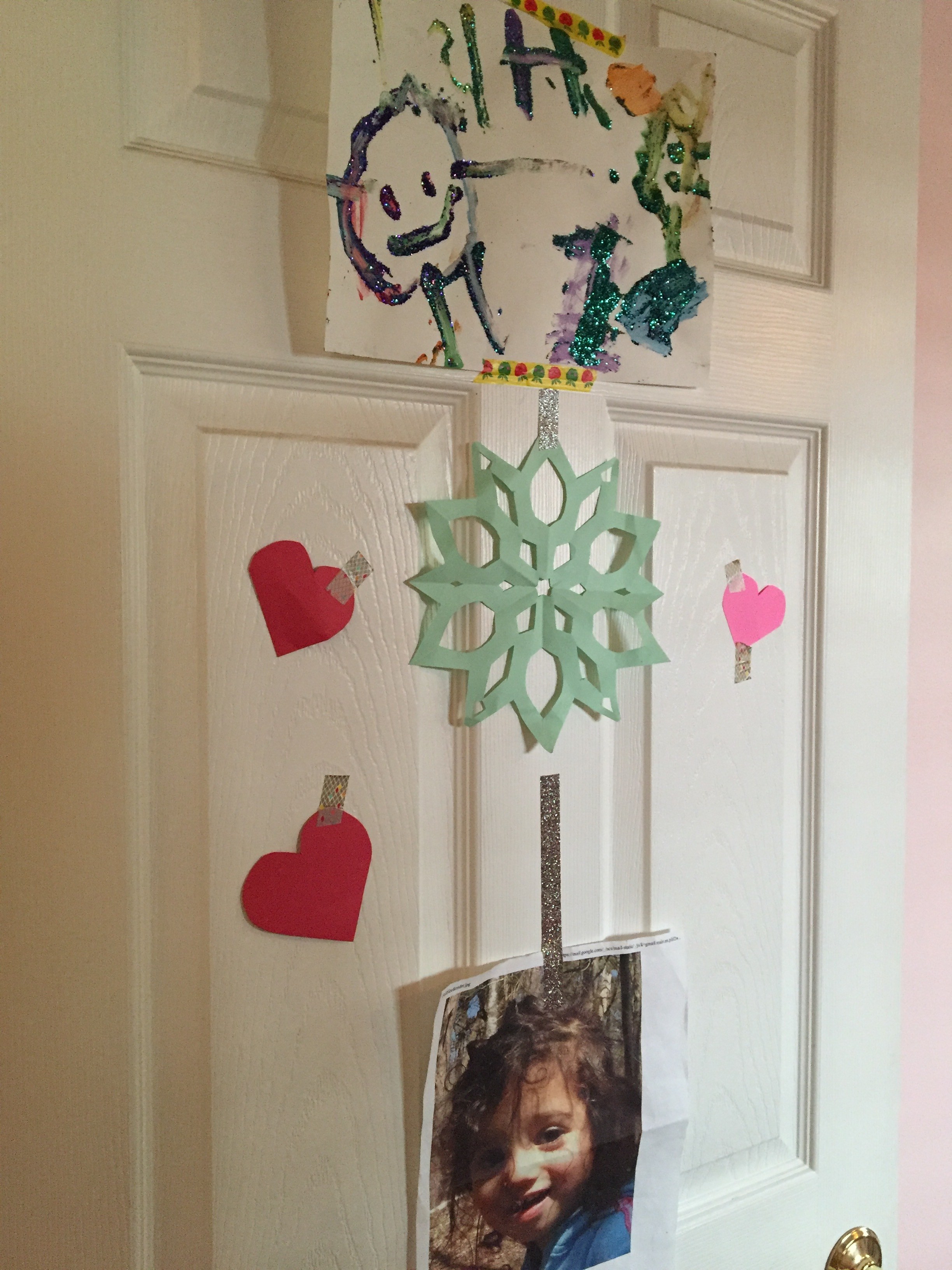 Meena's Door: We put up whatever she wants on that door, so she gets to do all the decorating.  Everything is stuck on with washi tape, which is the BEST thing you can have when it comes to decorating a kid's room.