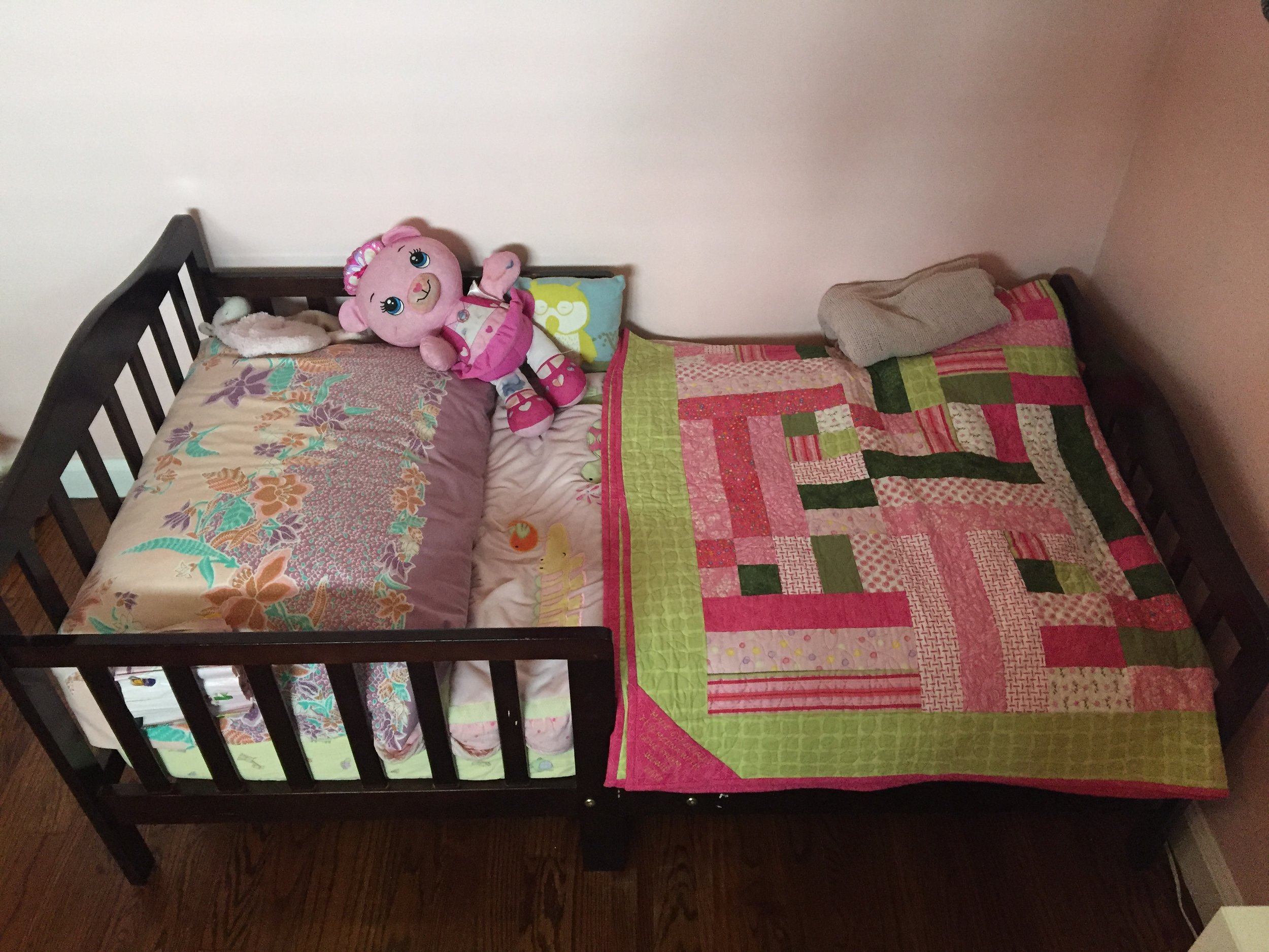 The toddler bed is just the perfect size for Meena, easy to get in and out of.  Meena likes to sleep facing the mermaid because she doesn't want to look at the closet.  Bed: Craigslist; Quilt: made by my MIL for Meena.