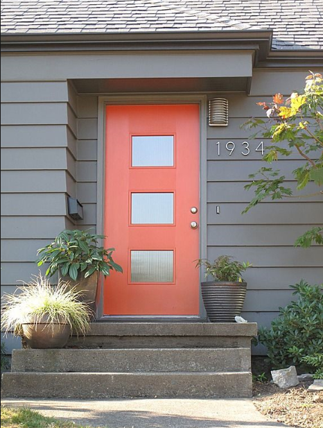Image Credit:  Pinterest   Love this mid century mod style door! Plus, that coral is the perfect pop against that dark gray.  And...those are the style of house numbers I'm thinking about.  AND...cool light. :)