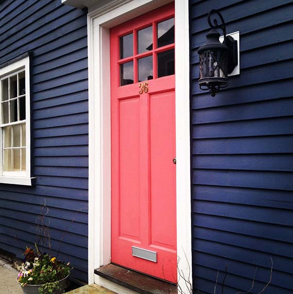 Image Credit: AspireMetro.com  I. LOVE. EVERYTHING. ABOUT. THIS.  A coral pink door popping against navy siding? Yes, yes, and forever, YES. I'm pretty sure there should be a law that says if you have navy siding (lucky!), you HAVE to paint your door this color.