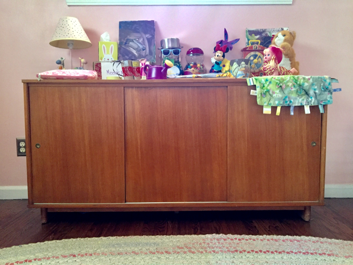 Here's a credenza that is in my daughter's room. She uses the top to organize a bunch of her toys (okay, she just throws stuff up there, and I do the organizing). I use the inside to store a ton of craft supplies.