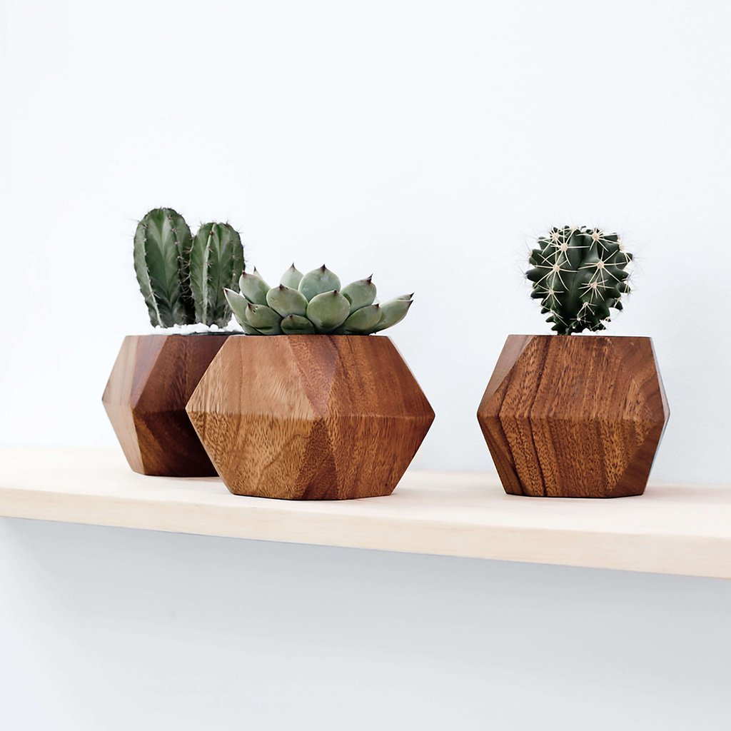 Adia Planter  - $65 for a single one, $185 for a set of 3 - handcarved from Mugavu wood - and new trees are replanted by the coop makers to replace the trees used.
