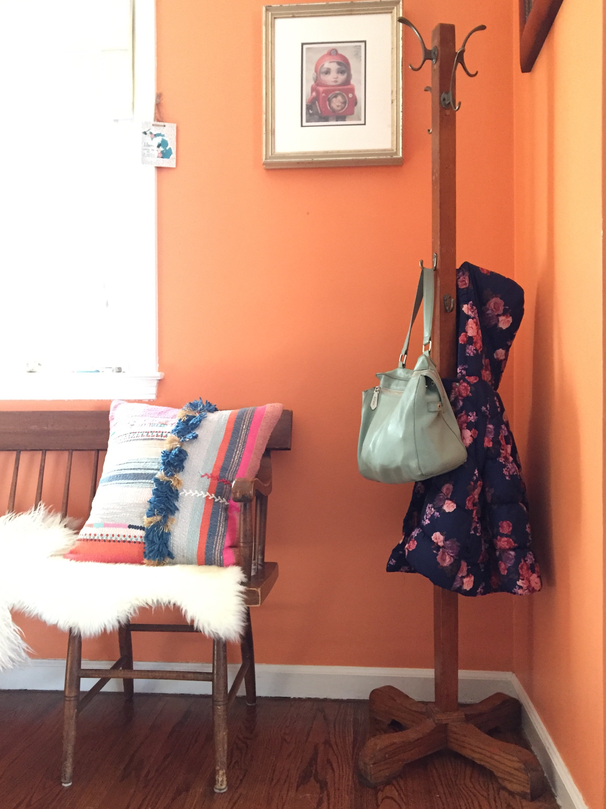 And here's a close-up of the coat rack side where the only thing on it is a purse and a cute little flower coat that take up very little visual space and happen to match perfectly with everything else in this space (more reality).