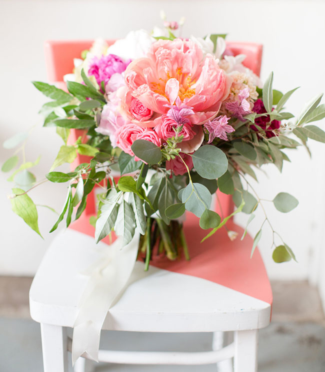 """Amanda Veronee (Eclectic Warehouse Wedding) This gorgeous bouquet is a """"boho-chic"""" fashionista's dream-come-true! The vibrant, yet chic, color palette is only made more impactful by the greenery. This arrangement of hot-pink peonies, hydrangeas, roses, and a dash of eucalyptus—formed into a loosely-structured bouquet—is sure to provide just the POP of color and texture that you've been looking for! (Photo by Amy + Jordan Demos)"""