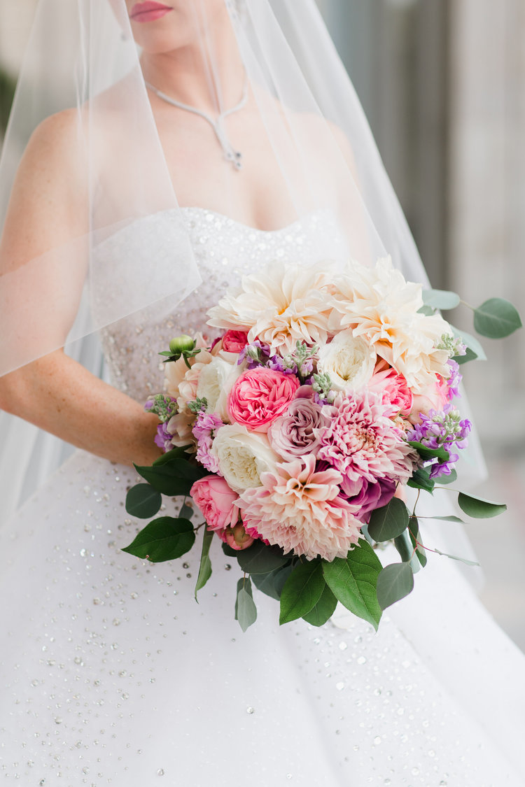 """Another Amanda Veronee favorite ...This GLAMOROUS bouquet beckons to the romantic in every woman! Following a sophisticated color palette—featuring creams, blush pinks, and light purples—and inspired by the """"vintage glam"""" wedding theme, this arrangement is both refined and cohesive. Tightly arranged—but not forced—ranunculus and dahlias make this bouquet uniquely elegant—while the lavender roses provide a bit of extra charm! Be still my heart…! (Photo by Annamarie Akins Photography!)"""