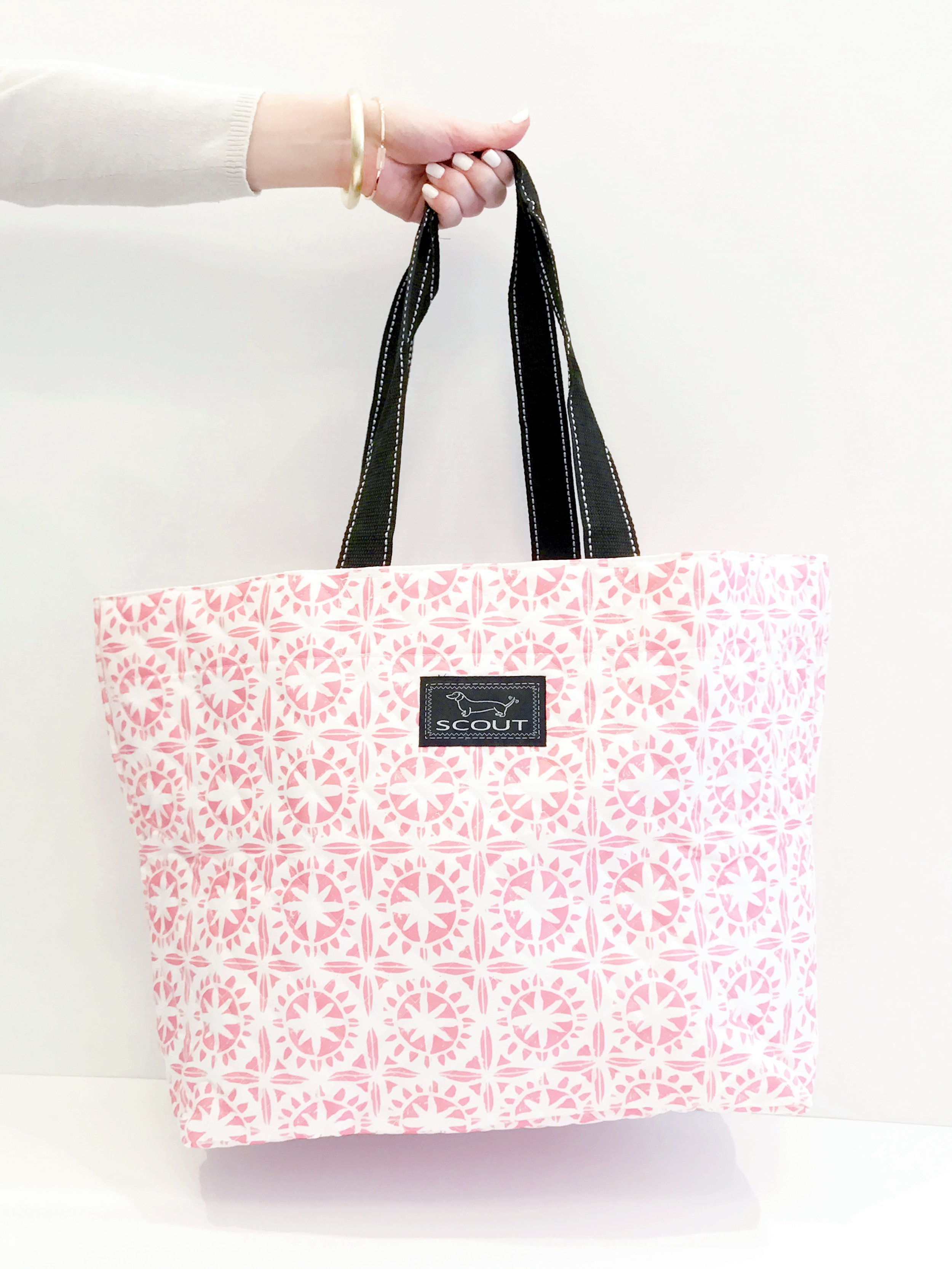 Scout bags have some fun and bright new patterns this Spring for makeup bags, travel bags, insulated lunch boxes, and even wine bags!I especially love the large tote bag - - you can fold it up into a small pouch and then it opens up into a full size tote!Trendy and practical, you definitely can't beat that!
