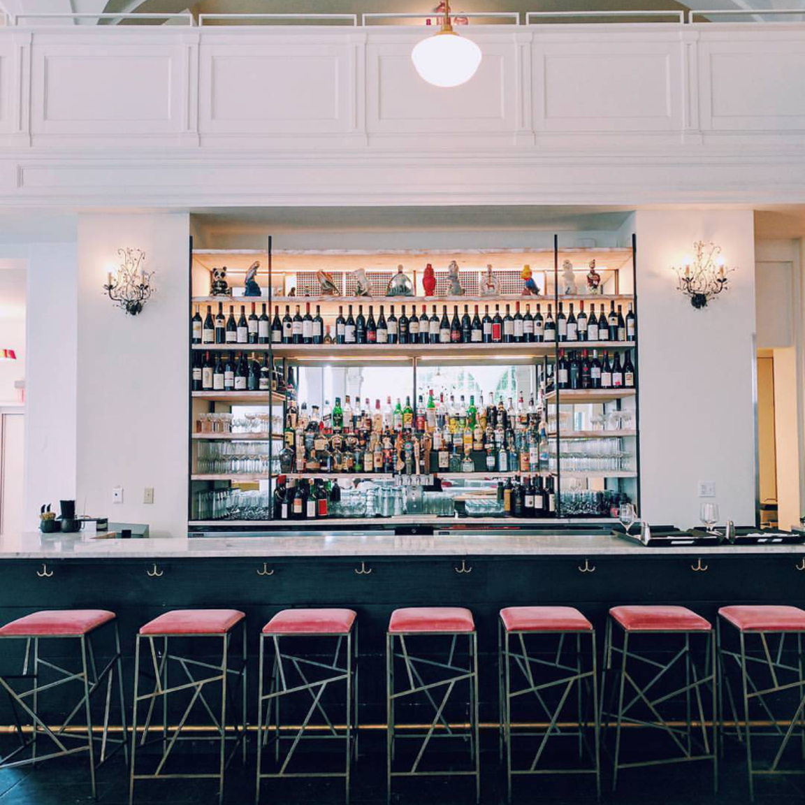 Who wouldn't want to sip something delicious from this bar?! I mean look at those velvet stools!