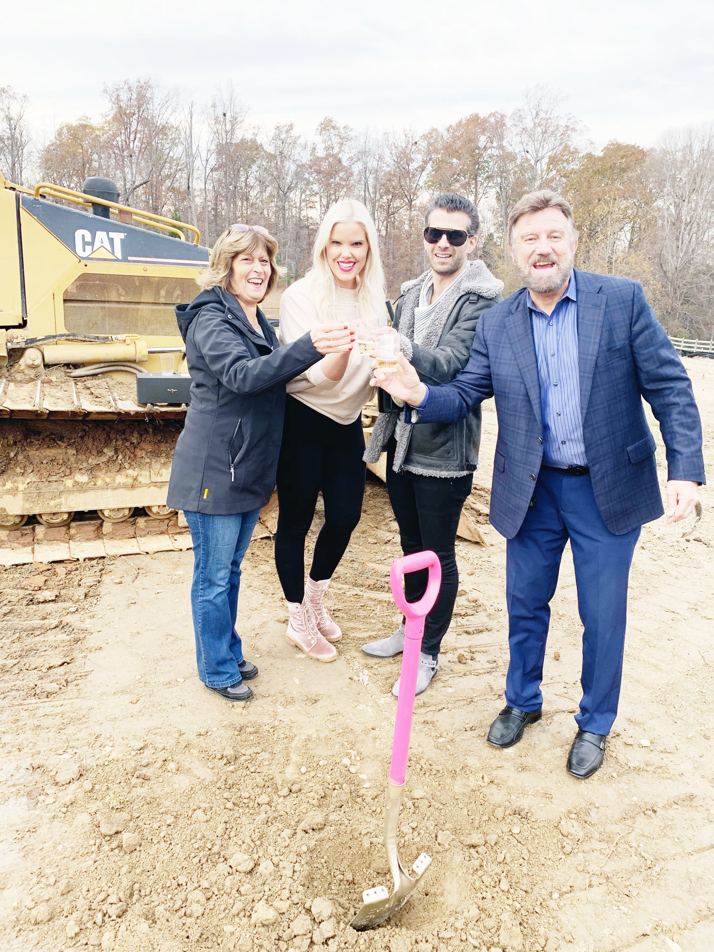 How cute is this pink and gold shovel 😭 Our builder, Scott, is AMAZING! PS: That's Costa's parents!