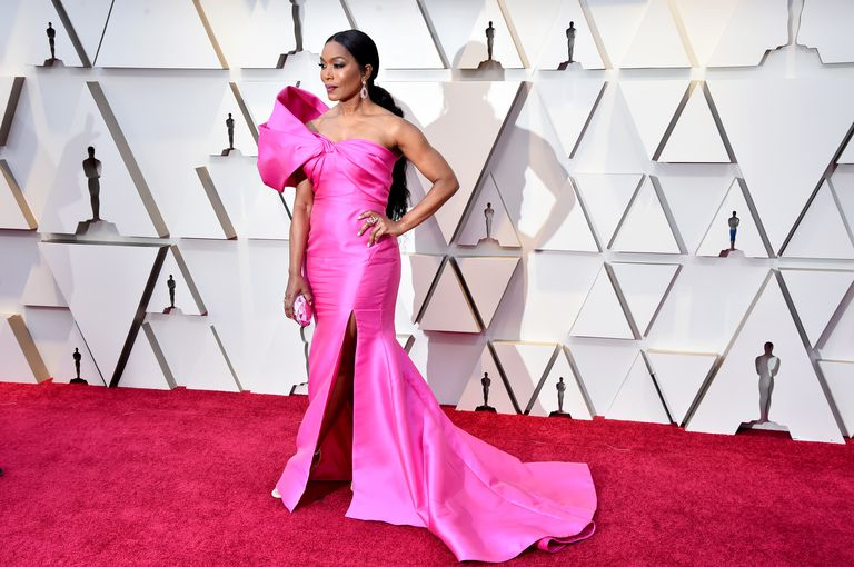 Angela Bassett - This Reem Acra gown brought all of the drama to the red carpet. The one shoulder dress fits Bassett perfectly— and proves that strong women look even more fierce in the color pink— and to think there was a point when I shied away from the color!(pc Getty Images + Jeff Kravitz)