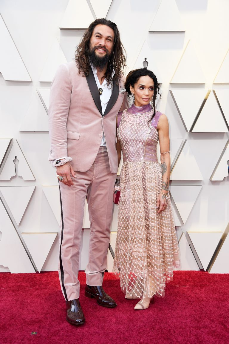 Lisa Bonet (& Jason Momoa) - Lisa Bonet looks absolutely stunning in this Karl Lagerfeld dress. I am so happy to see her paying homage to the late designer and looking beautiful while doing it! Her best accessory of the night was her beau, Jason Momoa, who complimented her outfit perfectly in a blush Karl Lagerfeld suit— I'm pretty sure Momoa might have become the definition of trophy husband. What are the odds that I can get my hubby to put on a blush suit?(pc Getty Images + Frazer Harrison)