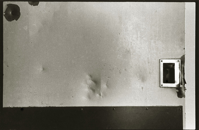 This image is of a door in a bedroom in the women's ward. The indentations you see in the metal were made by a fist.