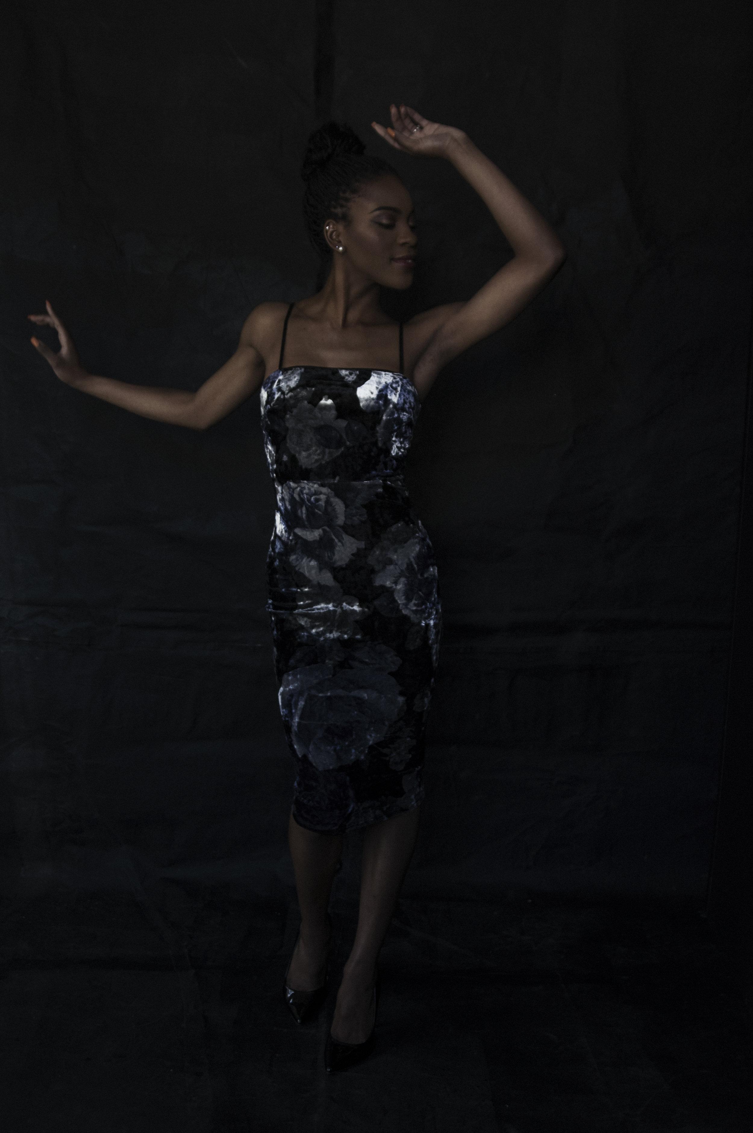 Dark portrait of a woman dancing