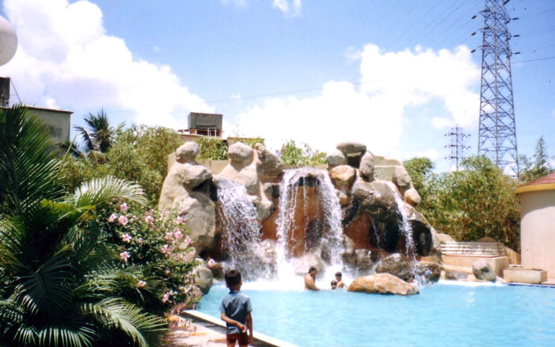 Artificial waterfall made along the pool