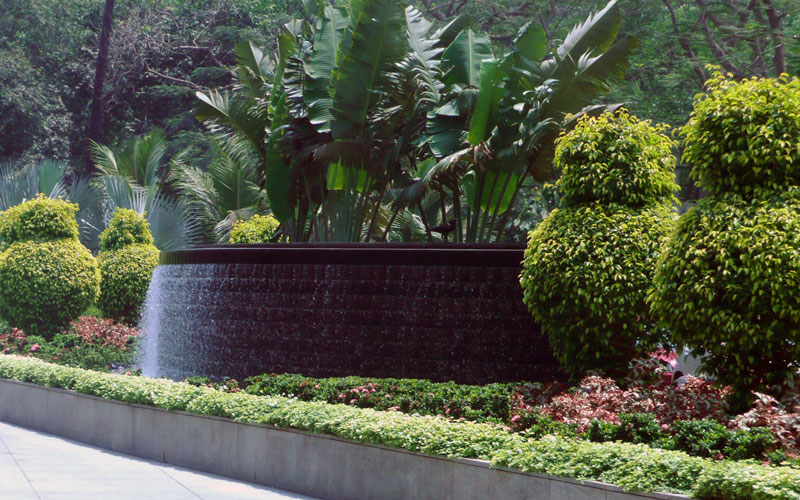 Wall feature cascade and manicured plantation for a hotel