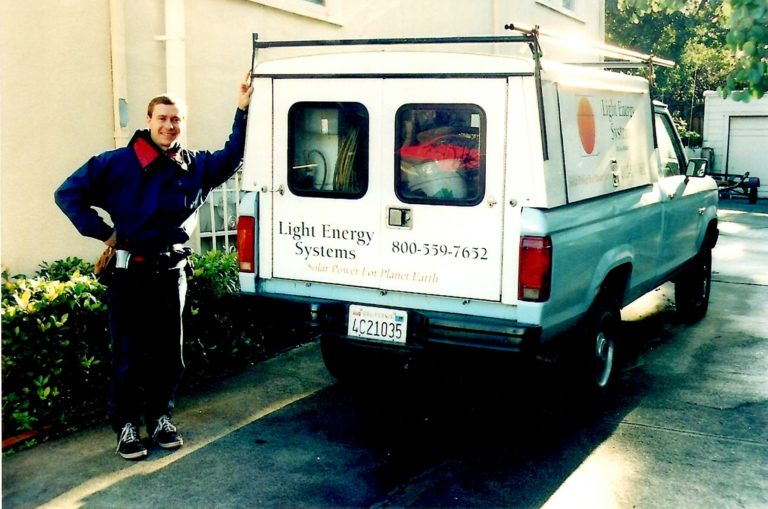 Michael poses with his solar install truck in 1999