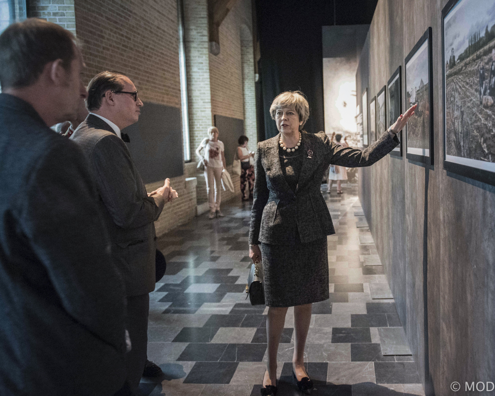 Above, left to right - artist Ian Alderman, Assistant curator Dominiek Dendooven, Prime Minister Theresa May