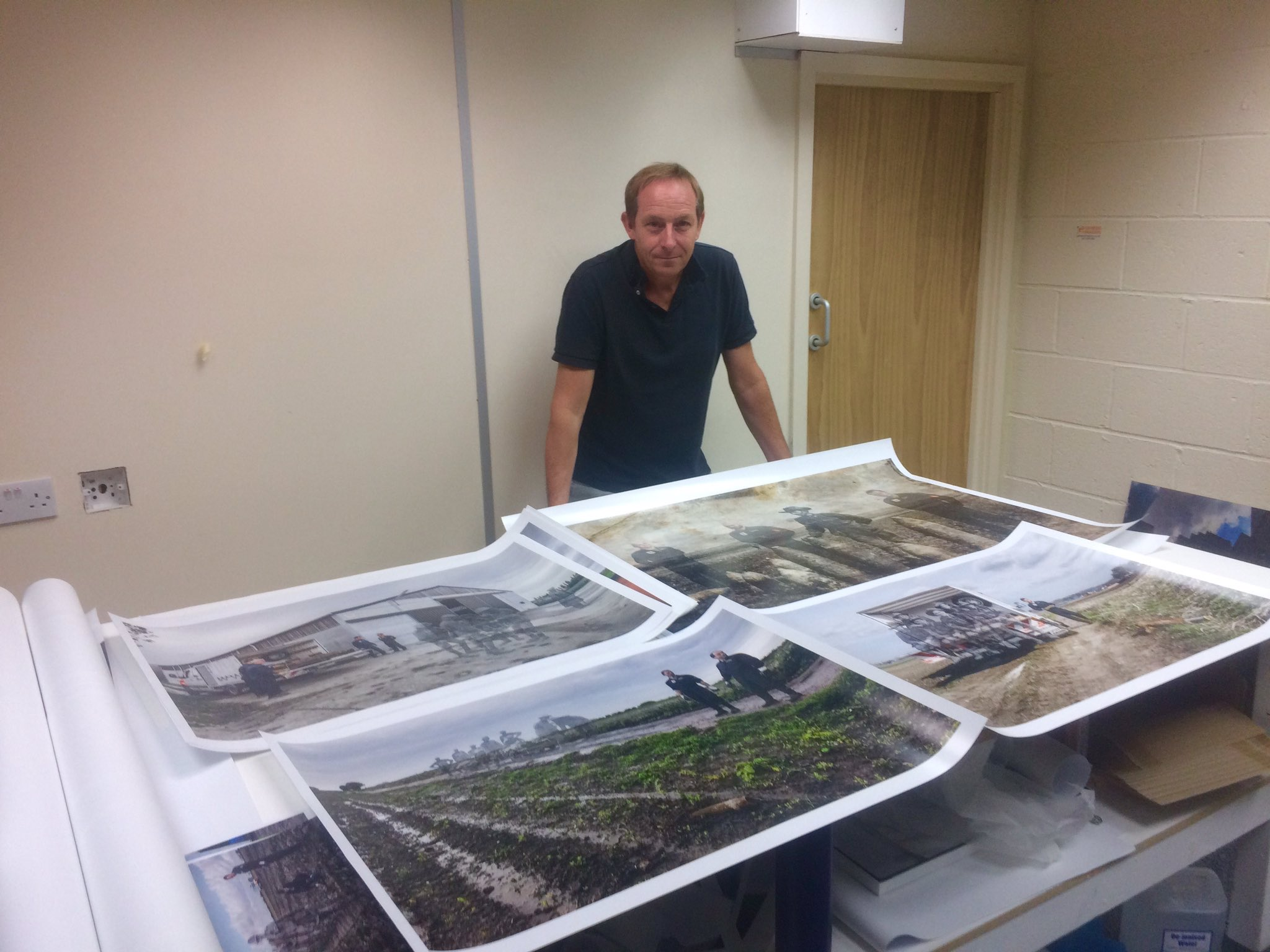 Artist Ian Alderman with the prints destined for the Australian debut of 'Recovering The Past'