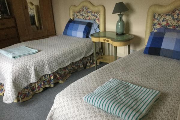 nightingale-fitness-retreat-twin-bedroom.png