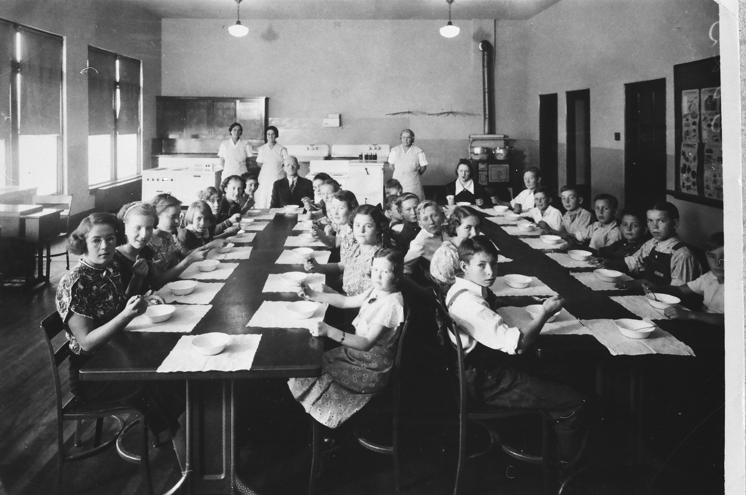 The first hot lunch served at the Salem school to those who didn't have lunch from home. Taken in 1938. My grandpa would've been 11 at the time, although he is not in the picture.  Photo source.
