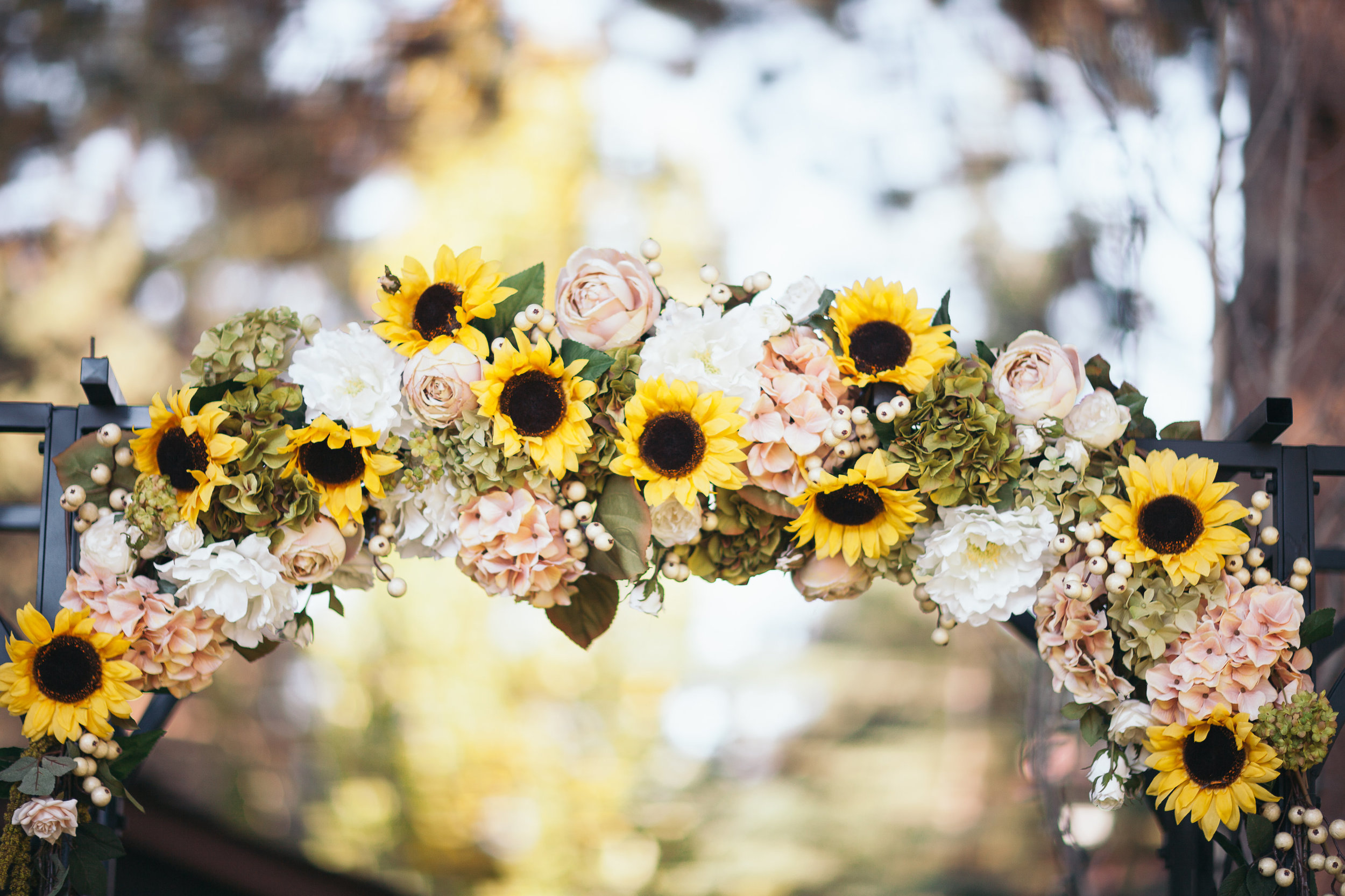 My older sister, Katie created this from flowers from a craft store. This is what we stood under when we greeted guests.