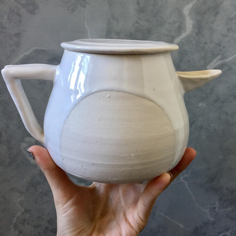 white cutout teapot.jpg